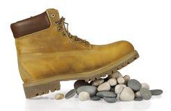 Gele laarzen op de stenen Royalty-vrije Stock Afbeeldingen