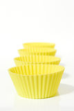 Gele muffinvormen Stock Foto
