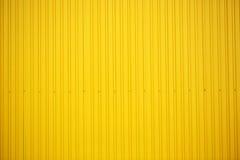 Gele muur stock afbeeldingen