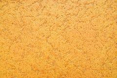 Gele muurachtergrond stock afbeelding