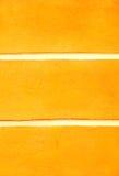Gele muurachtergrond Stock Foto's