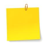 Gele nota met oranje Paperclip Royalty-vrije Stock Afbeelding
