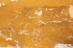 Gele oude muurtextuur Stock Afbeeldingen