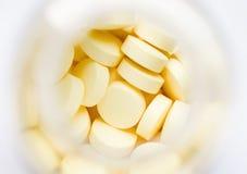 Gele pillen Stock Foto