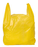 Gele plastic zak stock foto's