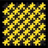 Gele puzzelstukken op zwarte achtergrond Stock Foto