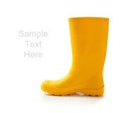 Gele rainboots op wit met exemplaarruimte Stock Afbeeldingen