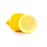 Gele rijpe die citroen op een wit wordt geïsoleerd Stock Foto's