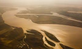 Gele rivierzonsondergang Stock Afbeeldingen