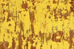 Gele roest op een metaalmuur, de oude achtergrond Royalty-vrije Stock Foto