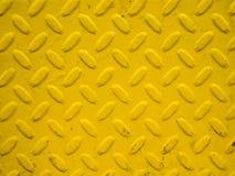 Gele staalachtergrond Stock Foto's