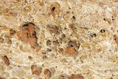 Gele steenachtergrond met willekeurige holten stock afbeelding