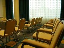 Gele stoelen Stock Afbeeldingen