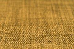 Gele stoffentextuur Abstracte achtergrond, leeg malplaatje Stock Foto's