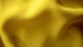 Gele stoffentextuur voor achtergrond stock fotografie