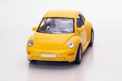 Gele stuk speelgoed auto Royalty-vrije Stock Afbeeldingen