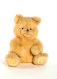 Gele teddybeer die op wit wordt geïsoleerde Stock Foto's