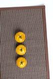 Gele tomaten op mat Stock Afbeelding