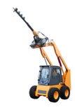 Gele tractor met het boring van installatie Stock Foto