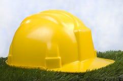 Gele veiligheidshelm Stock Foto's