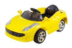Gele verre controlemechanismestuk speelgoed geïsoleerde auto Royalty-vrije Stock Afbeelding