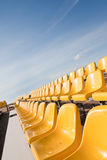 Gele zetels Stock Foto