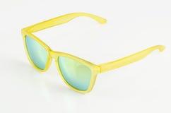 Gele zonnebril royalty-vrije stock afbeeldingen