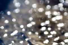 Gelegentliche Lichter funkt, Blinzeln, Blitze sich reflektieren im Glas als abstra Stockbilder