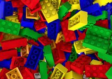 Gelegentlicher bunter Spielzeugplastik blockiert Hintergrund Lizenzfreies Stockbild
