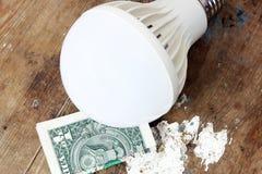 Geleide lamp met geld Royalty-vrije Stock Fotografie