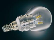 Geleide lampclose-up op donkere achtergrond De bol van de besparingsenergie Stock Foto