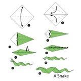 Geleidelijke instructies hoe te om origamislang te maken Stock Foto