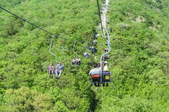 Gelendzhik, Russia - April 30.2017: Tourists climb and descend by cable car over the spring and the slope of the Markotkh mountain. Range in the Safari Park Royalty Free Stock Image