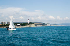 Gelendzhik, Russia a boat with a sail on the sea in the background thick Cape Stock Photos