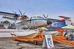 Amphibian aircraft L410UVP-E20 is demonstrated at the exhibition area on the Black Sea coast in the parking. stock image