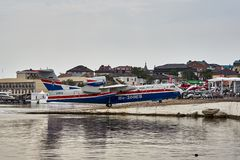The multipurpose amphibian aircraft Beriev Be-200ES returns to base after demonstration flights over the Black Sea water royalty free stock photography