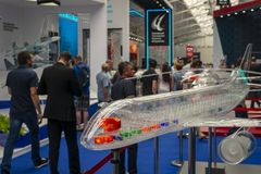 The transparent layout of the plane and the male visitors to the exhibition stock photo