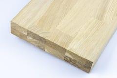 Gelijmde houten structuur Timmerhout industri?le houten textuur, de achtergrond van houtuiteinden Uiteindeeind van een verwerkte  royalty-vrije stock foto