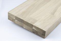 Gelijmde houten structuur Timmerhout industri?le houten textuur, de achtergrond van houtuiteinden Uiteindeeind van een verwerkte  royalty-vrije stock fotografie