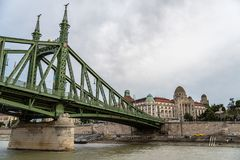 Gellert Thermal Baths and Liberty Bridge in Budapest. Budapest, Hungary - August 12, 2017: Gellert Thermal Baths and Liberty Bridge in Budapest. The bath complex royalty free stock photography