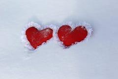 Gelo e neve quentes do derretimento dos corações imagens de stock royalty free