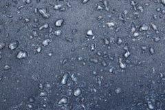 Gelo sul nero Immagine Stock