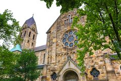 Gelsenkirchen germany cityscape. Church with trees stock photos
