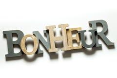 Geluk (Bonheur) Witte achtergrond Royalty-vrije Stock Afbeelding