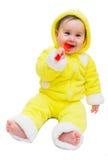 Gelukkig babymeisje in gele en rode lepel Stock Foto