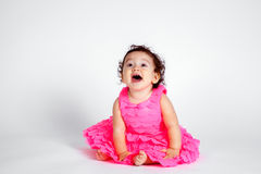 Gelukkig Babymeisje in Roze op Witte Achtergrond Royalty-vrije Stock Fotografie