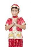 Gelukkig Chinees nieuw jaar Jonge Aziatische jongen met gebaar van gelukwens Royalty-vrije Stock Afbeelding