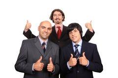 Gelukkig commercieel team met omhoog duimen Stock Fotografie