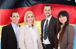 Gelukkig Duits zakenlui stock afbeelding