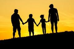 Gelukkig familiesilhouet Stock Fotografie